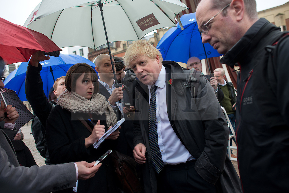 © Licensed to London News Pictures.06/11/2013. London, UK. Mayor of London, Boris Johnson talks to journalists. London's first segregated section of Barclays Cycle Superhighway has been launched at Stratford High Street.Photo credit : Peter Kollanyi/LNP