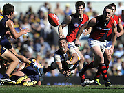 20/08/2011 SPORT: AFL - West Coast Eagles vs Essendon Bombers at Patersons Stadium, Perth. PICTURED - Eagle Daniel Kerr fires out a desperate handball.