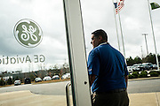 "AUBURN, AL – NOVEMBER 20, 2016: Ricardo Acevedo, plant manager at General Electric's Auburn facility, stands outside the newly built plant in Auburn's West Technology Park. Acevedo says GE chose Auburn in 2014 as their first site to use 3D printing to make high-volume products because it could count on an educated workforce and include the university as a partner in research. Currently GE is printing 50,000 jet engine nozzles a year using 30 3D printing machines, with intentions of doubling the machines in 2017. ""We need to understand the properties of the metal powder to get more consistent results,"" Acevedo said. <br /> <br /> In much of the United States, global trade and technological innovation has failed to produce the prosperity hoped for by political and business leaders. Yet despite formidable economic challenges, some localities are flourishing. In Lee County, Ala., unemployment is below the national average despite the loss of thousands of manufacturing jobs, and the key to the county's resilience may be Auburn University, which provided a steady source of employment during recessions and helped draw new businesses to replace those that fled. CREDIT: Bob Miller for The Wall Street Journal<br /> [RESILIENT]"