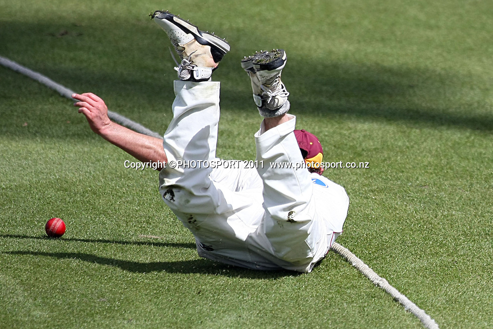 Hamish Marshall dives to save four runs for the Knights,Cricket, Northern Knights Vs The Auckland Ace's during day two of their Plunket Shield Game at Seddon Park in Hamilton, Wednesday 16 March 2011.<br /> Photo: Dion Mellow / photosport.co.nz