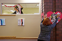 Vickie Nostrant, left, and Trudy Elliott, both withNorth Idaho Home Health, decorate the new Dirne Community Health Center office space Wednesday for Valentine's Day. The team of volunteers from North Idaho Home Health spent an hour hanging ribbons, placing balloons and stuffed animals, and hanging paper hearts with photos of Dirne care providers in the office space at 1090 West Park Place Drive in Coeur d'Alene.