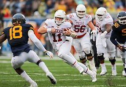 Nov 18, 2017; Morgantown, WV, USA; Texas Longhorns quarterback Sam Ehlinger (11) runs the ball during the third quarter against the West Virginia Mountaineers at Milan Puskar Stadium. Mandatory Credit: Ben Queen-USA TODAY Sports