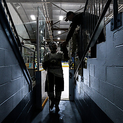 "TRENTON, ON  - MAY 3,  2017: Canadian Junior Hockey League, Central Canadian Jr. ""A"" Championship. The Dudley Hewitt Cup Game 3 between Dryden GM Icedogs and Powassan Voodoos.    Tyson Gilmour #23 of the Powassan Voodoos high fives a fan as he walks off the ice<br /> (Photo by Alex D'Addese / OJHL Images)"
