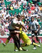 Twickenham. UK. Australia grapple with Fiji's Apisai DOMOLAILAI, during the Cup semi final at the 2015. Marriott London Sevens. RFU Twickenham Stadium. Surrey. 17.05.2015. [Mandatory Credit: Peter Spurrier/Intersport Images]