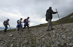 Early morning climbers make their way up the slopes of Croagh Patrick for the annual pilgrimage that took place yesterday.<br /> Pic Conor McKeown