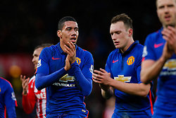 Chris Smalling of Manchester United looks dejected as he applauds the away fans after the match finishes with a 1-1 draw - Photo mandatory by-line: Rogan Thomson/JMP - 07966 386802 - 01/01/2015 - SPORT - FOOTBALL - Stoke-on-Trent, England - Britannia Stadium - Stoke City v Manchester United - New Year's Day Football - Barclays Premier League.