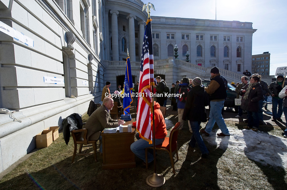 Democratic State Rep. Fred Clark (C) and other Democratic Representatives set up their offices outside of the state Capitol on March 2, 2011 in Madison, Wisconsin. Four Democratic assembly members set up offices outside the building, claiming that restrictions on entry to the state Capitol prevented the public from having sufficient access to their representatives.   (Photo by Brian Kersey)