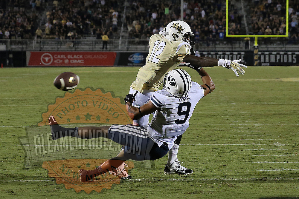 ORLANDO, FL - OCTOBER 09: Jacoby Glenn #12 of the UCF Knights breaks up a pass to Jordan Leslie #9 of the Brigham Young Cougars to win the game in overtime at Bright House Networks Stadium on October 9, 2014 in Orlando, Florida. UCF won the overtime game 31-24. (Photo by Alex Menendez/Getty Images) *** Local Caption *** Jacoby Glenn; Jordan Leslie