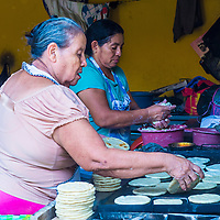 SUCHITOTO , EL SALVADOR  - MAY 07 : Salvadoran women prepares Popusas in Suchitoto El Salvador on May 07 2016. Popusa is a traditional Salvadoran dish made of corn tortilla