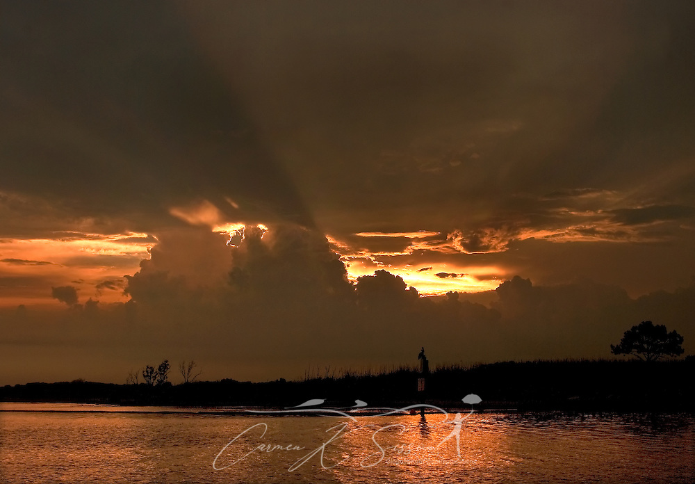 The sun sets over the water in Bayou La Batre, Ala., June 14, 2010. (Photo by Carmen K. Sisson/Cloudybright)