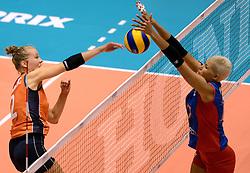 08-08-2014 NED: FIVB Grand Prix Nederland - Puerto Rico, Doetinchem<br /> Femke Stoltenborg slaat de bal in het blok van Ocasio