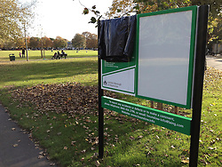 "© Licensed to London News Pictures. 29/10/2011. London, UK.  An incorrectly placed sign on Acton Green with the incorrect name covered by the council. Residents in Chiswick, West London, were surprised to find their locals parks had changed names overnight. Council workers have erected new signposts in the wrong parks which are half a mile apart. Turnham Green and Acton Green now both have signs naming them as Turnham Green. The signs have caused much local amusement. One local Hounslow councillor described the mixup as ""embarrassing"". Photo: Stephen Simpson/LNP"