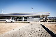 Pisticci Scalo, Basilicata, Italia 27/01/2016 <br /> L'ingresso all'aerostazione dell'aviosuperficie &quot;E.Mattei&quot;. <br /> Indicata anche come aviosuperficie di Basilicata, si trova a Pisticci Scalo, in provincia di Matera.<br /> <br /> La struttura venne realizzata negli anni '60, durante l'industrializzazione della val Basento, su iniziativa di Enrico Mattei, per una sua personale maggiore rapidit&agrave; di spostamento tra i siti ENI.<br /> <br /> Inutilizzata per molto tempo, nel 2007 &egrave; stato consegnato alla Regione Basilicata un progetto da 8 milioni di euro che prevede la costruzione di opere infrastrutturali e di potenziamento dei servizi per la realizzazione di un aeroporto civile regionale di terzo livello.<br /> <br /> Il 22 maggio 2014 &egrave; stata affidata dal CSI (consorzio per lo sviluppo industriale) di Matera la gestione della stessa aviosuperficie alla societ&agrave; aerotaxi Winfly, che ha sede all'Aeroporto di Pontecagnano, vicino Salerno.<br /> <br /> Al momento, la struttura consente l'atterraggio a velivoli con una capienza massima di nove posti.<br /> <br /> Pisticci Scalo, Basilicata, Italy, 27/01/2016<br /> The terminal building entrance of the airstrip &quot;E. Mattei&quot;.<br /> Also named as &quot;Airfield of Basilicata&quot;, it is located in Pisticci Scalo, near Matera.<br /> <br /> The structure, a simple airstrip, was built in the 60s, during the industrialization of the Basento valley, on the initiative of Enrico Mattei, for a faster personal transfer between ENI company sites.<br /> <br /> Unused for a long time, in 2007 it was delivered to the Basilicata Region a project including the construction of infrastructure and expanding services for the construction of a third tier regional civil airport, with a total planned investment of about 8 million Euros.<br /> <br /> On the 22nd May 2014 the CSI (Consortium for Industrial Development) of Matera entrusted the management of the airfield to the air taxi Winfly company