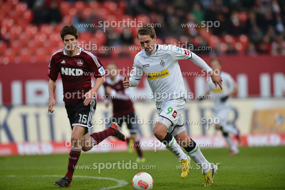 03.02.2013, easyCredit Stadion, Nuernberg, GER, 1. FBL, 1. FC Nuernberg vs Borussia Moenchengladbach, 20. Runde, im Bild Luuk DE JONG (Borussia Moenchengladbach/ rechts) im Laufduell mit Timm KLOSE (1.FC Nuernberg/ links). Action / Aktion // during the German Bundesliga 20th round match between 1. FC Nuernberg and Borussia Moenchengladbach at the easyCredit Stadium, Nuernberg, Germany on 2013/02/03. EXPA Pictures © 2013, PhotoCredit: EXPA/ Eibner/ Matthias Merz..***** ATTENTION - OUT OF GER *****