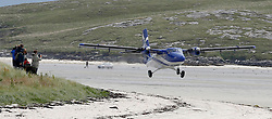 Barra Airport is a short-runway airport situated in the wide shallow bay of Traigh Mhòr at the north tip of the island of Barra in the Outer Hebrides, Scotland. Barra is now the only beach airport anywhere in the world to be used for scheduled airline services. Loganair Twin Otter taking off. c) Stephen Lawson | Edinburgh Elite media