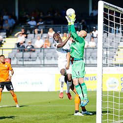 Dovers forward Ntumba Massanka forces Barnets keeper Mark Cousins to collect the ball during the National League match between Dover Athletic and Barnet FC at Crabble Stadium, Kent on 1 September 2018. Photo by Matt Bristow.