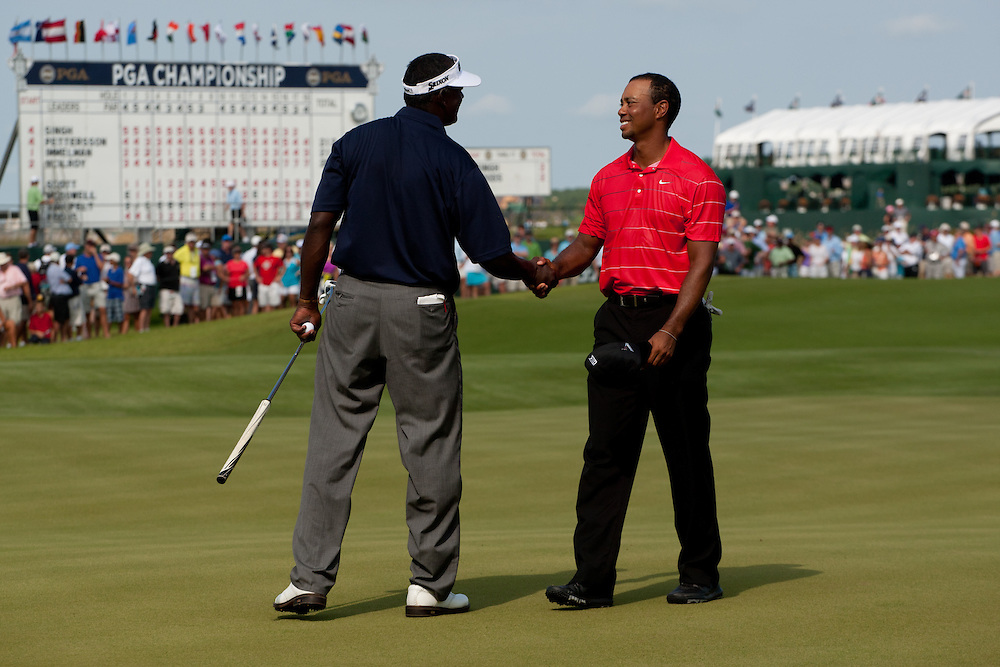 KIAWAH ISLAND, SC - AUGUST 12:  Tiger Woods shakes hands with playing partner Vijay Singh of Fiji after the third round of the 2012 PGA Championship at The Ocean Course on Kiawah Island, South Carolina on August 12, 2012. (Photograph ©2012 Darren Carroll) *** Local Caption *** Tiger Woods,Vijay Singh