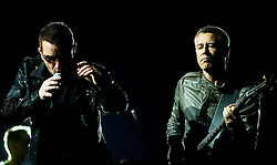 Bono U2 front man and Adam Clayton on bass guitar performs with the band during their 2009  360 tour at Sheffield  Don Valley Stadium 20 August