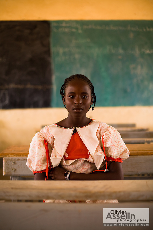 "Adjatou Traoré, 13, sits in a classroom at the Petit Paris primary school in the town of Dori, 240 km northeast of Burkina Faso's capital Ouagadougou on Monday May 11, 2009. When she was 12, Adjatou's mother attempted to sell her to a Ghanaian man who was trying to find his son a wife. She refused the marry the man. ""Early marriage is not a good thing,"" she says, ""because a child should never have to give up school."""