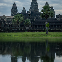 Angkor Wat is a temple complex in Cambodia and the largest religious monument in the world.  It was originally built as a Hindu temple of god Vishnu for the Khmer Empire.