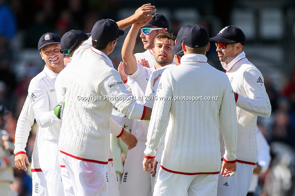 Picture by Alex Whitehead/SWpix.com - 29/05/2015 - Cricket - 2nd Investec Test: England v New Zealand, Day 1 - Headingley Cricket Ground, Leeds, England - England's Mark Wood is congratulated on the wicket of New Zealand's BJ Watling (bowled).