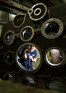 Bob Gray works on a windmill gearbox assembly at Kalt Manufacturing in North Ridgeville, OH