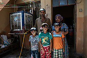 9 August 2018 – Mosul – Iraq – A family is photographed inside their home in the Wadi Hadjar neighbourhood of West Mosul. <br /> <br /> This home is amongst the houses due to be rehabilitated in West Mosul with the support of UNDP's Funding Facility for Stabilization (FFS). <br /> <br /> © UNDP Iraq / Claire Thomas