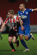 Luke Thomas and Luke Daly during the FA Trophy match between Cheltenham Town and Chelmsford City at Whaddon Road, Cheltenham, England on 12 December 2015. Photo by Antony Thompson.