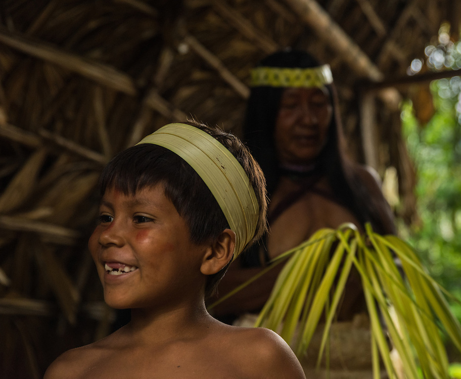 Boy from the Huaorani tribe with a decoration around his head.
