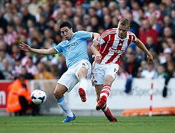 Stoke City's Ryan Shawcross and Manchester City's Samir Nasri battle for the ball - Photo mandatory by-line: Matt Bunn/JMP - Tel: Mobile: 07966 386802 14/09/2013 - SPORT - FOOTBALL -  Britannia Stadium - Stoke-On-Trent - Stoke City V Manchester City - Barclays Premier League