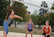 Allie Haines, center, and other members of her intramural volleyball team play a game on South Beach on Sept. 30, 2014. Photo by Lauren Pond