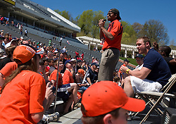 Chris Long (right) and other former Virginia Cavaliers football players answer fans questions before the start of the UVA spring game.  The Virginia Cavaliers football team played the annual spring football scrimmage at Scott Stadium on the Grounds of the University of Virginia in Charlottesville, VA on April 18, 2009.  (Special to the Daily Progress / Jason O. Watson)