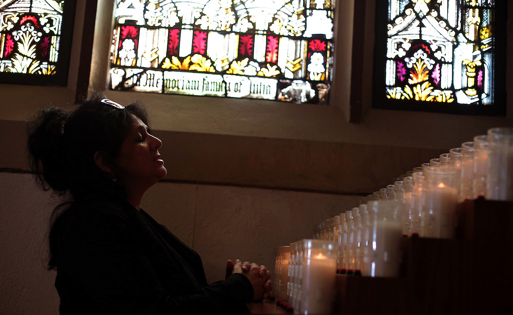 Diana DeLouise of Yonkers prays at an altar after Ash Wednesday services, marking the beginning of Lent, at St. John the Baptist Parish in Yonkers. (Feb. 13, 2013)