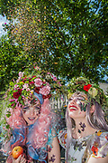 Spreading a bit of sparkle in Duke of Yorks Square - British couturier to royalty, Catherine Walker & Co. stages a showcase of its designs to pay tribute to the RHS Chelsea Flower Show and celebrate its 40th anniversary. Models were dressed in Spring Summer couture, complemented by floral and butterfly head dresses and make-up.