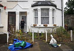 © Licensed to London News Pictures. 07/07/2019. London, UK.  A police officer stands in front of medical equipment, at the entrance to a property in Enfield, North London, where a mother and three daughters, all under 12, have been stabbed by a man. The attacker is believed to be known to the victims. Photo credit: Ben Cawthra/LNP