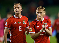 DUBLIN, IRELAND - Tuesday, October 16, 2018: Wales' Andy King (L) and Matthew Smith (R) celebrate after their 1-0 victory the UEFA Nations League Group Stage League B Group 4 match between Republic of Ireland and Wales at the Aviva Stadium. (Pic by David Rawcliffe/Propaganda)