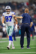 ARLINGTON, TX - OCTOBER 14:  Head Coach Jason Garrett and Geoff Swaim #87 of the Dallas Cowboys on the field before a game against the Jacksonville Jaguars at AT&T Stadium on October 14, 2018 in Arlington, Texas.  The Cowboys defeated the Jaguars 40-7.  (Photo by Wesley Hitt/Getty Images) *** Local Caption *** Jason Garrett; Geoff Swaim
