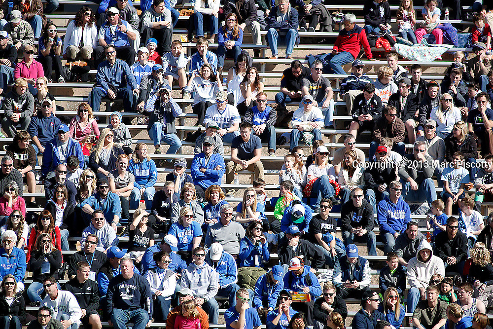 SHOT 3/2/13 1:39:03 PM - Air Force lacrosse fans took advantage of some warm weather and sunshine while watching their team play Marquette at Falcon Stadium in Colorado Springs, Co. Marquette won the game 8-6 marking their first ever win as a new program. (Photo by Marc Piscotty / © 2013)