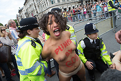 Image ©Licensed to i-Images Picture Agency. 07/07/2014. London, UK. Femen protesters try to storm the Tour the France. Female protesters from Femen movements get detained near the route where the Tour the France is expected to pass. Parliament Square. Picture by Daniel Leal-Olivas / i-Images