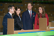 Picture by Mark Larner/Barcroft Media. Picture shows, ltor: Crown Prince Frederick and Crown Princess Mary of Denmark Prince William, Duke of Cambridge, Katherine, Duchess of Cambridge, being shown the packing line inside the Copenhagen UNICEF Distribution Depot 02/11/2011...The Duke and Duchess of Cambridge are today visiting children's charity Unicef's emergency supply centre in Copenhagen with with the Crown Prince Frederik and Crown Princess Mary of Denmark.