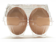 two eggs in transparent plastic storage holder