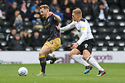 Derby County forward Martyn Waghorn challenges Sheffield Wednesday defender Tom Lees for the ball during the EFL Sky Bet Championship match between Derby County and Sheffield Wednesday at the Pride Park, Derby, England on 9 March 2019.