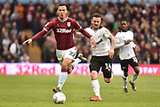 Aston Villa striker (on loan from Lille) Anwar El Ghazi (22) battles for possession  with Derby County striker Jack Marriott (14) during the EFL Sky Bet Championship match between Aston Villa and Derby County at Villa Park, Birmingham, England on 2 March 2019.