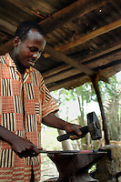 Ghana, Adaklu, Titikope, 2007. Traditional skills with  working metal make the village blacksmith an important member of this countryside community.
