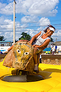 Girls on bucking bull ride in Ciro Redondo, Ciego de Avila, Cuba.