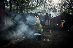In a refugee camp near Ukhia, Bangladesh. A woman is preparing food.<br />