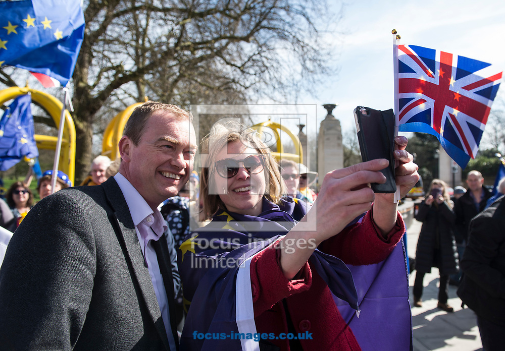 Tim Farron, leader  of the Liberal Democrats, has announced he is standing down in the wake of the General Election.  Westminster, London<br /> Picture by Daniel Hambury/Stella Pictures Ltd 07813022858<br /> 14/06/2017<br /> <br /> SPL TIM FARRON MP 09.jpg<br /> <br /> Original Caption:<br /> Tim Farron MP poses for a selfie with a member of the public at Unite for Europe march, starting in Park Lane and ending in a rally in Parliament Square.<br /> Picture by Daniel Hambury/Stella Pictures Ltd 07813022858<br /> 25/03/2017