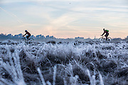 UNITED KINGDOM, London: 18 January 2017 Cyclists make their way through a frosty Richmond Park during sunrise this morning. Temperatures dropped to -4C in certain parts of the capital last night causing wide spread frost. Rick Findler / Story Picture Agency