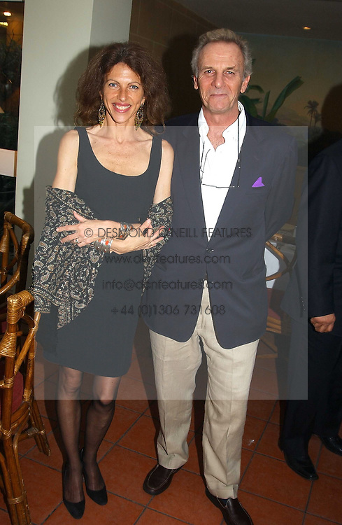 MARK &amp; CLEO SHAND he is the brother of HRH The Duchess of Cornwall at a fundraising dinner for the charity 'Elephant Family' held at The Bombay Brasserie, Gloucester Road, London on 26th April 2005.<br />