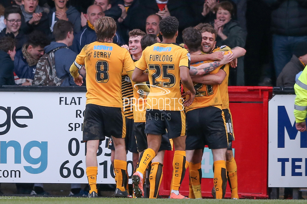 Cambridge United forward Ben Williamson scores Cambridge United  third goal  during the Sky Bet League 2 match between Cambridge United and York City at the R Costings Abbey Stadium, Cambridge, England on 20 February 2016. Photo by Simon Davies.